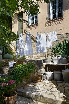 I want to do this in courtyard. . . . a simple laundry line strung from porch to tree.