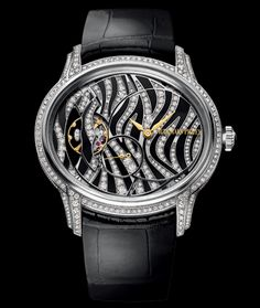 AWESOME Audemars Piguet Millenary, hand-wound manufacture caliber 5205.  18 karat white gold, diamond and onyx dial. Available at Cellini Jewelers