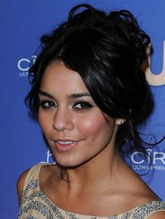 Take beauty inspiration from Vanessa Hudgens! Try silver and black eye makeup with shimmery cheeks and clear lip gloss!