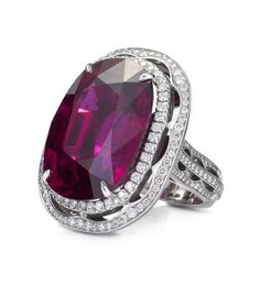 A lively, colourful ring from Boodles' Vintage Lace collection, set with a cushion-cut rubellite of 28.69ct and surrounded by 1.09ct of round-brilliant cut diamonds in platinum.