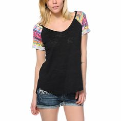 A Black burnout fabric is contrasted by multicolor tribal print raglan sleeves in the Workshop Electric tee shirt for women. The lightweight and soft blended construction paired with the relaxed fit with scoop neckline and rounded bottom hems gives you th