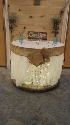 For food and gift table. Lights under white table cloth with burlap accents