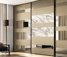 MIsuraemme Segmenta Wardrobe System exterior which is glass/matt and gloss laquer - to be personalised to client