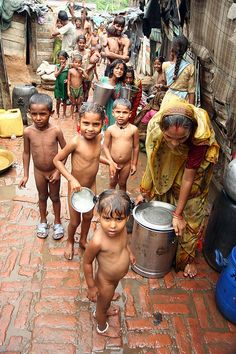 INDIA POVERTY Indian below poverty line children residing slums bath as the locality gets water once in fortnight, in the Northern Indian city of Jammu, the winter capital of Kashmir on 25 June In a sign of growing entrepreneurship and We Are The World, Our World, People Around The World, Around The Worlds, Namaste, India People, Slums, Incredible India, Amazing