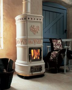 Wood heating stove / traditional / ceramic / earthenware - OVALE - LA CASTELLAMONTE Stufe di Ceramica