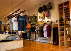 surf board from ceiling Clothing Store Interior, Clothing Store Displays, Clothing Store Design, Surf Store, Skate Store, Retail Store Design, Retail Stores, Store Interiors, Shop Interior Design