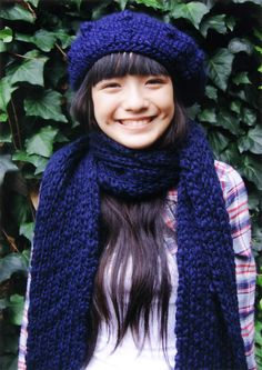 in dark blue hat and scarf