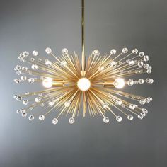 Adorned with colorful acrylic beads, the color pop gold beaded urchin chandelier is the perfect modern statement piece that pops against any background. Lead Time: 1 Week Measurements: - Diameter: 27 in - Height: 12 in - Weight: 8 lbs Features: - Finishes Chandeliers, Chandelier Lighting, Modern Chandelier, Nursery Chandelier, Dining Chandelier, Chandelier Ideas, Beaded Chandelier, Decor Interior Design, Interior Decorating