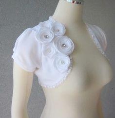 Wedding dress shrug... good for covering tattoos!
