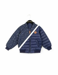 Dark blue reversible lightweight puff jacket with quilted fabric on one side and dot-printed fabric on the other. The jacket is lightly padded, has a front zip