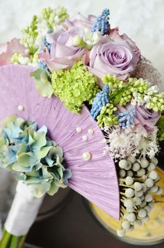 """New bouquet design from Petite Petals (www.facebook.com/...) """"Fan shape bouquet. You can have endless possibilities in here using raffia, fabrics, etc.... In this photo: Ocean song rose, queen ann lace, muscari, viburnum and syringa."""""""