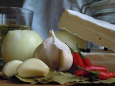 Pickled Brie with Onions, Chilly, Garlic...
