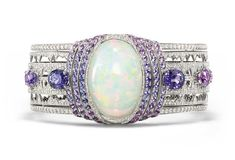 Chaumet bracelet in white gold set with a 39.05ct cabochon-cut white opal from Ethiopia, brilliant-cut diamonds, and oval-cut violet sapphires from Ceylon and Madagascar and round violet sapphires. From the Lumieres d'Eau high jewellery collection.