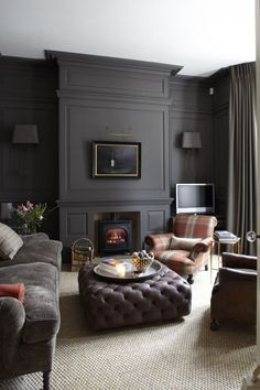 Wall-to-wall carpeting warms up this stately charcoal gray family room.