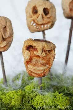 Shrunken Heads made from dehydrated carved apples. Creepy! The kids will love making these for Halloween.