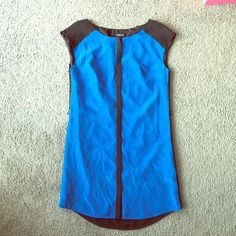 Bebe Shift Dress Chic! Sleeveless Color block Shift dress with hidden button closure running down the middle. Excellent vibrant blue color in front and all black in the back. In excellent used condition. Unfortunately missing the sash, but can be replaced easily. No stains or holes. Sorry, no trades. bebe Dresses