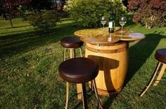 'The Badger' 4 Leaf Clover Oak Barrel Table & Stools - a wine barrel table with a four-leaf clover top design & four matching wine barrel padded stools. This highly ingenious & functional design works especially well for al-fresco dining in the garden, on patios or terrace areas, for weddings and birthday parties, and in the hospitality sector.  The stools are ergonomically designed to be used whilst sitting at the table. They have fabricated metal rings as foot rests and hand turned oak…