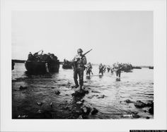 US soldiers advance towards land from the beaches at Normandy on D-Day, June 6, 1944. (American Stock Archive/Archive Photos/Getty Images)