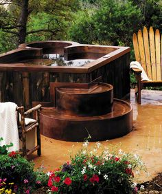 "COPPER SPA WITH PRIVATE THERAPY SEAT, BENCH SEATING,   COOL DOWN AREA, EXTERIOR STAIRWAY AND RECYCLED BARN BOARD SKIRTING  84"" x 114"" x 36""  Mountain Living Natural Dream Home 2007  Photo Credit: Audrey Hall"