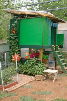 Backyard fort and child's garden. Holy smokes, what a magical looking play area~