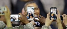 U.S. soldiers take pictures of U.S. President Barack Obama using their smartphones after he delivered a speech at U.S. military base Yongsan Garrison in Seoul, South Korea, April 26, 2014. REUTERS/Lee Jin-man/Pool