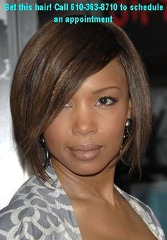 This sleek, bob (past jaw length) is gorgeous on a round face, especially paired with a long, severe side-swept bang.