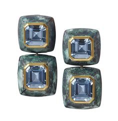 Katherine Jetter Four Madagascar emerald cut aquamarines, totaling over 16 carats, set in 22K gold and modern patinated bronze