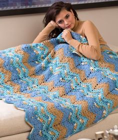 Rippling Waters Throw.. uses RED HEART® With Love® 2 skeins each of 1805 Bluebell A, 1938 Beachy B, 1502 Iced Aqua C, and 1308 Tan D