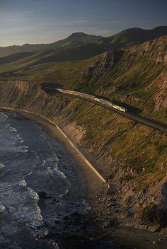 * The 'Coast Starlight' train snakes past the Santa Ynez Mountains, CA