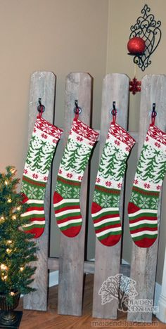Old fence piece to hold stockings - we no longer have a mantel so this is just perfect!