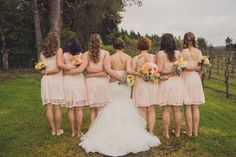 Mermaid Maggie Sottero gown in Ivory. It had a corset back, lace overlay on the bodice, and the skirt was made of hankie-cut tulle with lace appliques. The bridesmaids wore knee-length peach dresses with an illusion sweetheart neckline and a lace overlay.