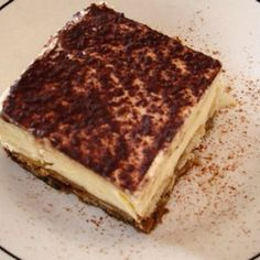Olive Garden Tiramisu - CopycatIngredients For Olive Garden Tiramisu  Copycat 4 egg yolks 2 tbsps milk 2/3 cup granulated sugar 2 cups mascarpone cheese 1/4 tsp vanilla extract 1 cup heavy cream 22 ladyfingers 1/2 cup espresso (cold) 1/4 cup kahlua 2 tsps cocoa powder