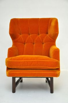 1stdibs | Dunbar Wingback Lounge Chair - Edward Wormley | Sculptural wing back lounge chair by Edward Wormley for Dunbar. All original orange tufted mohair | $8,800.00 | 1950's