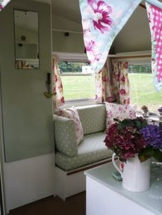 vintage camper interior this is the color scheme I like soft muted pastel greens browns and I like that pop of color with the flowers I could incorporate that some how.
