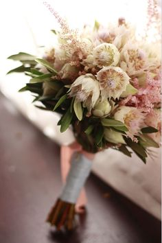Blushing bride protea and astilbe bouquet.  Throw in some lavender, rosemary, and thistle, and perfect!!