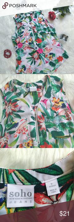 New York & Company SOHO sleeveless top New York and Company SOHO sleeveless top in a tropical floral pattern.  It is a white background with many different bright colors.  It has a v-neck with a zipper and two breast pockets.  It is made from a light flowy fabric perfect for summer!   Pet free smoke free home. New York & Company Tops