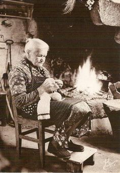 Grammy knitting by the fire