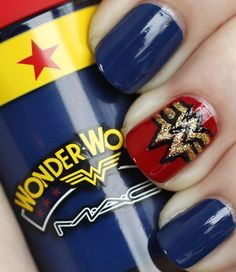 wonder woman OMG! did these and one finger was gold glitter each hand. 4th July awesome