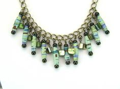 Blue/Green Paper Beads, Shell, and Brass necklace with Earrings - Bohemian, Shabby Chic, OOAK, upcycled. $39.00, via Etsy.