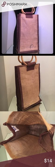 "EATALY BURLAP Wood O HANDLE tall lunch bag -wine 2 Super cool all natural lunch bag by Eataly! This lunch bag is tall enough to fit a bottle of wine in or two. It is commonly though used for a lunch bag and it is perfect for many occasions! A cute little conversation piece,  I mean everybody's going to ask where you got your bag! It is made in India, 5""x5"" wood round O-ring handles, 14"" in height, 8.25"" in width, 5"" in depth. LOVE IT! There is a tiny little spot that can probably be cleaned…"
