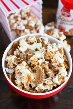 Biscoff Cookie Popcorn | Happy Friday! It's been a busy week and I am really looking forward to the weekend. If you plan on watching movies or March Madness this weekend, I have the perfect snack for you-Biscoff Cookie Popcorn with White Chocolate.  | From: twopeasandtheirpod.com