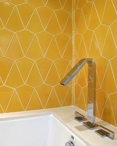 Here we chose to use some handmade tiles from Fireclay tile made in California. Beautiful patterns and beautiful saturated tiles helped bring some much needed color to this tub alcove. We then did an under mount tub encased in Caesarstone and paired it with a modern chrome deck mount fixture #caesarstone #fireclaytile #losangeles #studiojessejames #interiordesign #bathroomremodel #bathtub #architecture