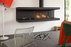 Open steel fireplace with panoramic glass STÛV Tulp Collection By Stûv Hanging Fireplace, Gas Fireplace, Fireplaces, Foyers, Home Heating Systems, Floating Glass Shelves, Wood Insert, Pellet Stove, Shower Shelves