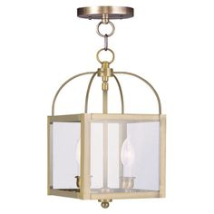 Bring a timeless touch to your foyer, dining room, or master suite with this classic convertible pendant, featuring a clear glass shade and antiqued brass fi...