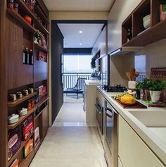 """Single-wall 'galley' kitchen with 8-12"""" storage wall on the back side. Leave room for a 33-42"""" window centered along the wall."""