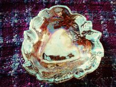 Check out this item in my Etsy shop https://www.etsy.com/listing/214518525/marigold-carnival-glass-candy-dish-with