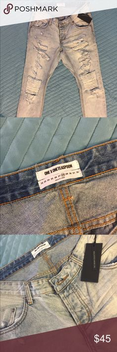 Distressed high waisted jeans size 28 NWT Size 28 but runs a bit larger in my opinion. Waist is 16 inches, length 27inches. Intentionally distressed throughout. A must have for the any fashion buff. One X one teaspoon Jeans Ankle & Cropped