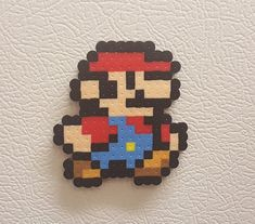 Mario Perler bead art pixel art Mario bead sprite 8 bit by PerlPop Hama Beads Mario, Perler Bead Mario, Diy Perler Beads, Pearler Beads, Melty Bead Patterns, Pearler Bead Patterns, Perler Patterns, Beading Patterns, Embroidery Patterns