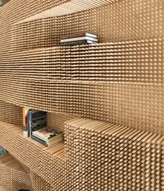 CATCH A WAVE: An undulating wall made from over 40,000 dowels adds a dose of awe to a Massachusetts loft. photos by: John Horner