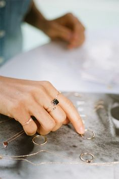 Dainty gold rings with black accents